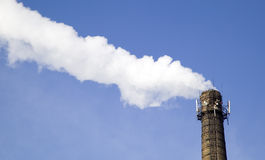 Chimney of factory with smoke stock images