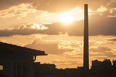 Chimney of a factory at sunrise Stock Photo