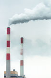 Chimney with fumes coming out Stock Image