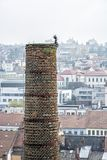 Chimney with funny figure in center of Trebic, Czech royalty free stock photo