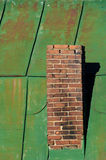 Chimney and Green Roof. Chimney on old green metal roof, vertical Stock Photography