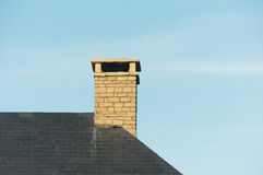 Chimney on house roof. With copy space Royalty Free Stock Photography