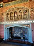 Chimney in Cardiff castle Wales, United Kingdom. Chimney in Medieval Cardiff Castle located in Wales United Kingdom. depiction of the 5 ancient cultures on top stock images