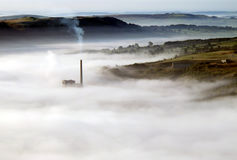 Chimney in the mist. Stock Photo