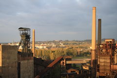 Chimney and oil rig. Partial view of the area of Lower Vitkovice, Ostrava, Czech Republic Royalty Free Stock Images