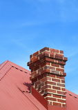 Chimney 2. Old fashioned red brick chimney on a roof top Royalty Free Stock Image