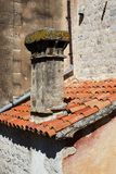 Chimney on an old tile roof Royalty Free Stock Photo