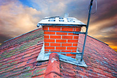 Chimney on orange and blue sky Stock Photo