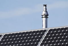 Chimney and photovoltaic cells Royalty Free Stock Photo