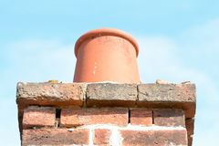 Chimney pot on top of chimney stack on roof Royalty Free Stock Photo