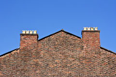 Chimney pots against a clear blue sky Stock Photo