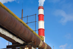 Chimney power plant against Stock Photos