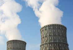 Chimney power plant against Royalty Free Stock Photos