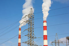 Chimney power plant against Royalty Free Stock Images