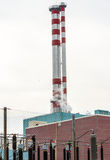 Chimney of a power plant. And some electrical equipment Stock Photo