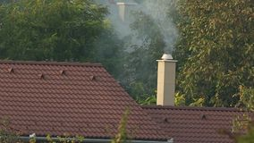 Chimney with rising smoke stock footage