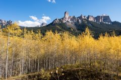 Chimney Rock and Court House Mountain stands above an aspen grove along Owl Creek Pass road. View of Chimney Rock and Court House Mountain from Owl Creek Pass royalty free stock photo