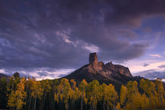 Chimney Rock at sunset with aspen trees in Fall Color Royalty Free Stock Photos
