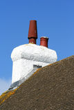 Chimney on a roof Stock Photos