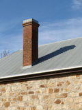 Chimney on a roof. Tall chimney on a roof with long shadow Royalty Free Stock Photography
