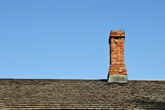 Chimney on Roof Stock Images