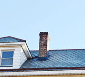 Chimney on the roof Stock Image
