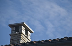 The chimney on the roof Stock Photos