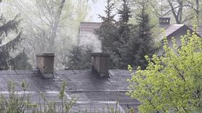 Chimney on roof stock video footage