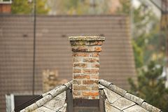 Chimney. On a roof of a house Royalty Free Stock Photography