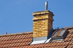 Chimney on the roof of house. Close up of house roof with chimney Royalty Free Stock Images