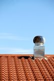 Chimney on the roof of the house Royalty Free Stock Photography