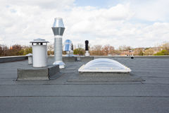 Chimney on the roof. Inox Chimney on the flat roof in the city Royalty Free Stock Images