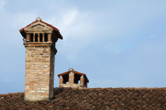 Chimney on the roof of the old church Royalty Free Stock Images