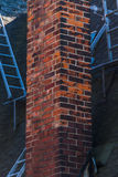 Chimney. Roof with shingles, ladders and brick chimney Stock Photos