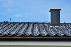 Chimney roof tiles Stock Photo