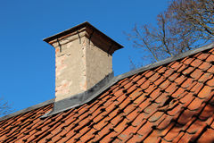 Chimney and rooftop on old cottage Stock Image