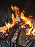 Chimney Scene. Fireplace with burning wood on an iron grill stock photography