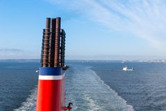 Chimney of a ship sailing at a blue sea Royalty Free Stock Photo