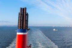 Chimney of a ship sailing at a blue sea. Chimney of a ferry ship sailing at a blue sea Royalty Free Stock Photo