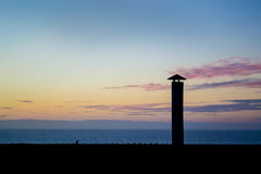Chimney sihlouette. Against the sunset Stock Image