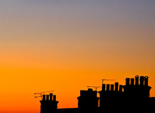 Chimney Silhouettes. Some chimneys from a terraced street at sunset royalty free stock photos