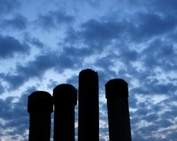 Chimney silhouettes. Of a building  at early morning Royalty Free Stock Photo