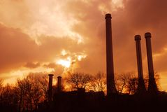 Chimney silhouettes. Chimney silhouttes under red sky stock photo
