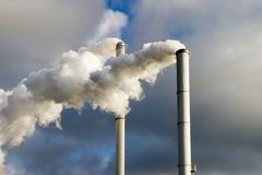 Chimney and smoke. The chimney of a factory with white smoke Stock Images