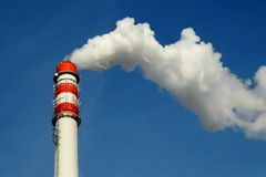 Chimney smoke. With blue sky stock image