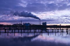 Chimney and Smoke at the blue hour. Chimney and smoke in habour at the blue hour Royalty Free Stock Image