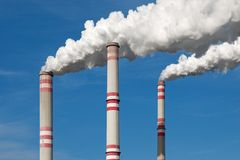 Chimney smoke with blue sky. A power plant - chimney smoke with blue sky Stock Image