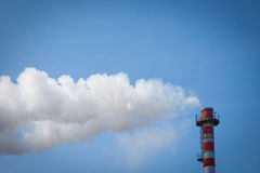 Chimney smoke. Chimney smoke with blue sky Stock Photo