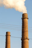 Chimney smoke with blue sky. The global Stock Image