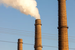Chimney smoke with blue sky. The global Stock Photography